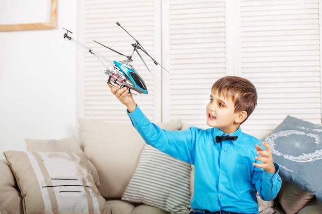 The little boy playing with an airplane