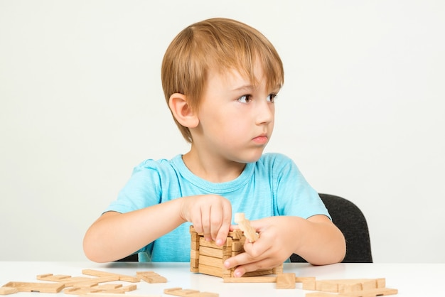 Little boy playing with building blocks on a table