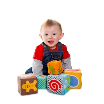 Little boy playing with colored soft cube