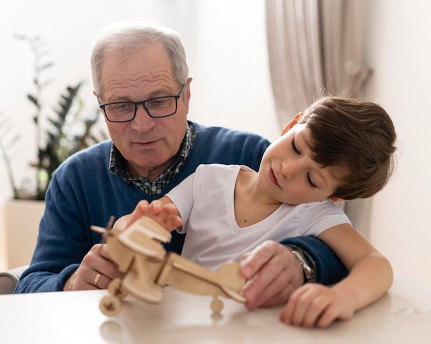 Little boy playing with his grandfather