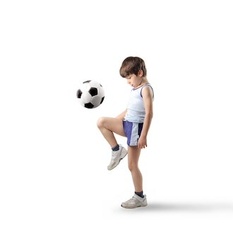 Little boy playing with a soccer ball