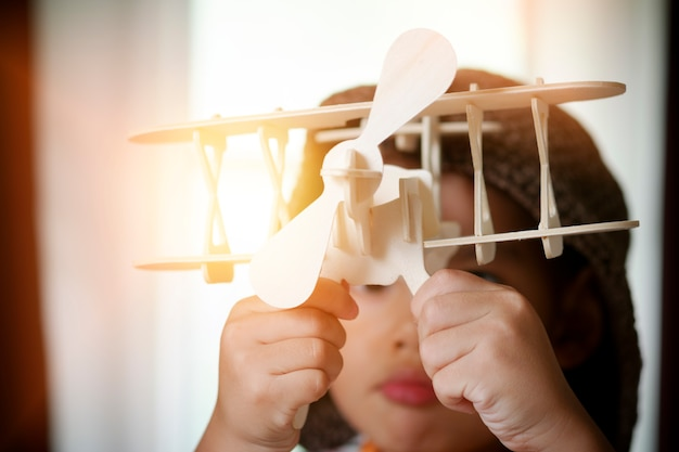 Little boy playing with toy airplane,travel and adventure concept