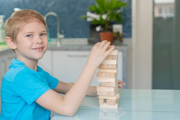 Little boy playing with wooden eco-friendly game
