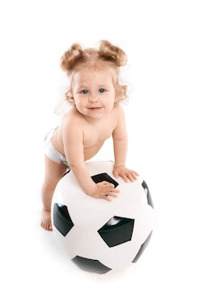 Little boy plays with a soccer ball