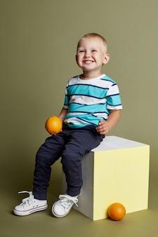 Little boy posing, cheerful emotions boy model