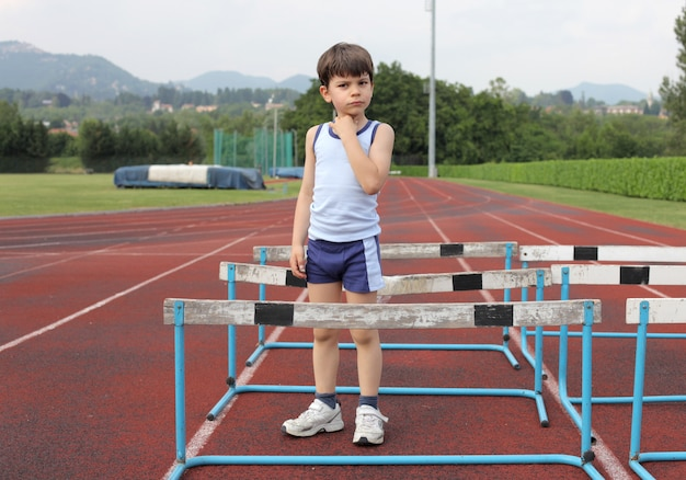 Little boy on the running track