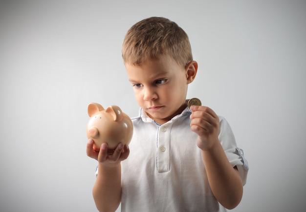 Little boy saving up