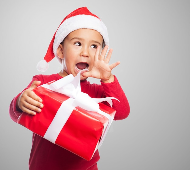Little boy screaming with his gift