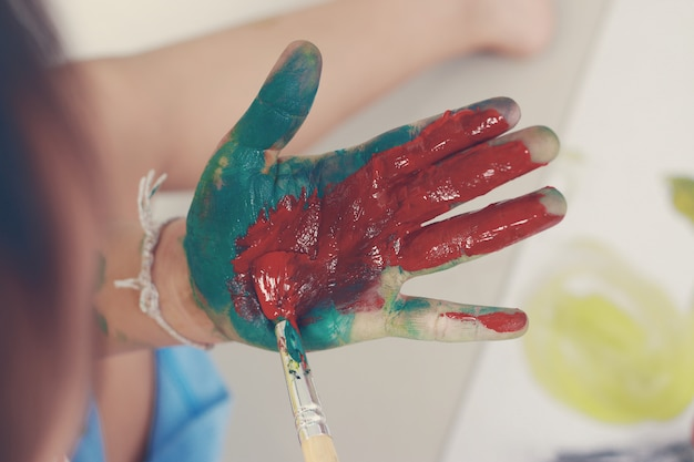 Little boy showing hands painted in colors