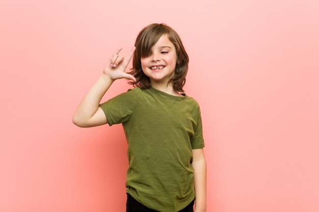 Little boy showing a horns gesture as a revolution concept.