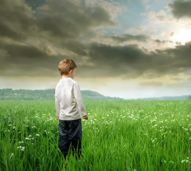 Little boy standing on a field