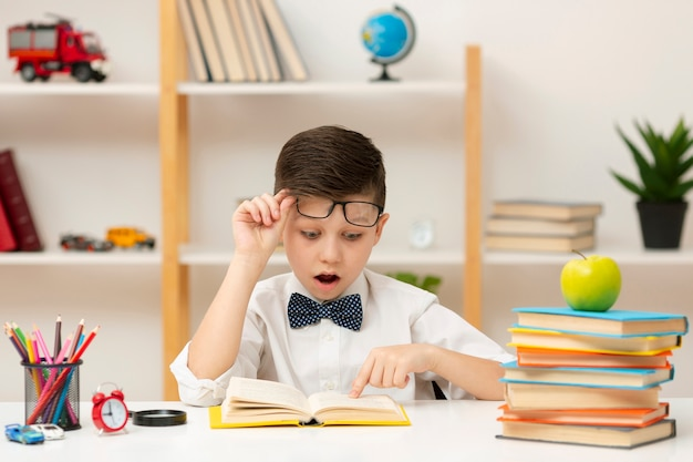 Little boy surprised by book content