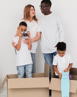 Little boy taking photos next to his family