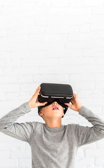 Little boy using virtual reality glasses