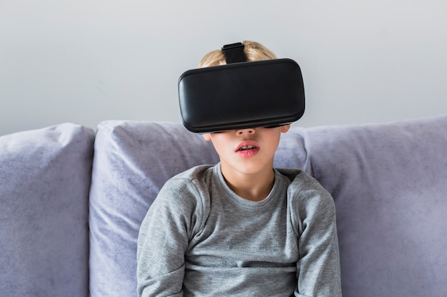 Little boy using virtual reality glasses