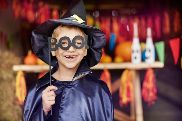 Little boy wearing a very scary mask