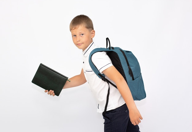 Little boy with back pack running right, isolated on white back to school