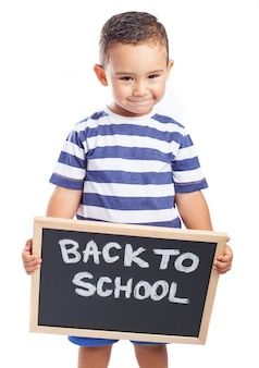 Little boy with a blackboard with the message
