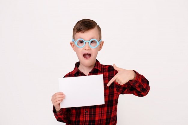 The little boy with expressive emotion on a white background.