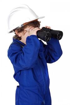 Little boy with helmet, binoculars and coveralls