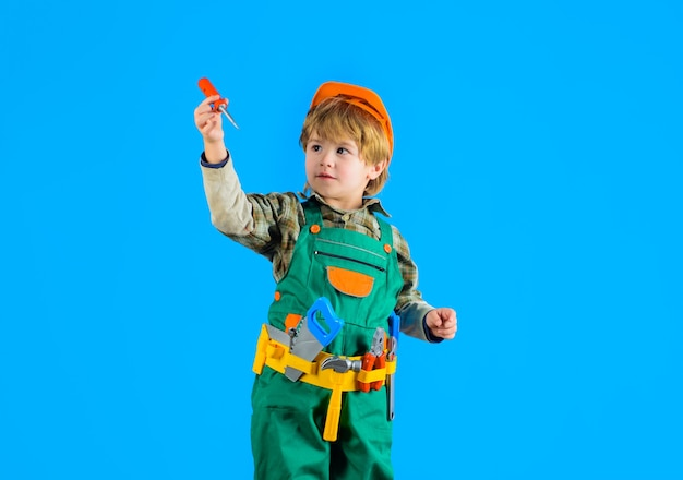 Little boy with helmet and tools builder kid game tools for building little repairman kid as