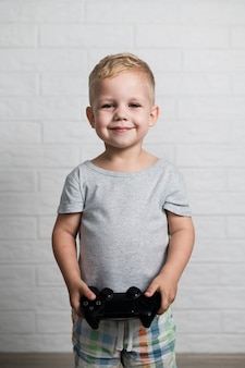 Little boy with joystick in hands at home