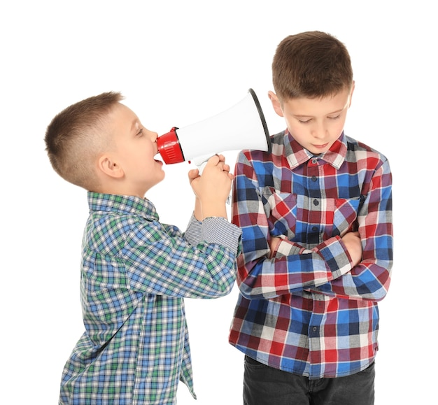 Little boy with megaphone shouting at another one, on white