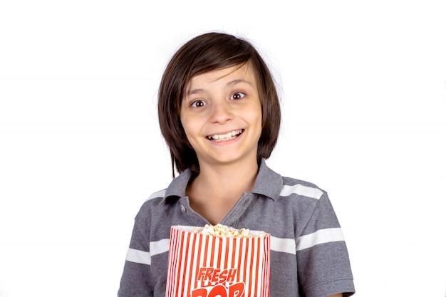 Little boy with popcorn.