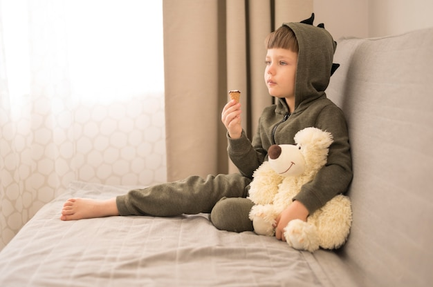 Little boy with tedy bear at home