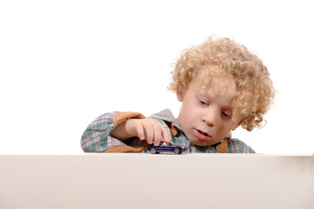 Little boy with toy car