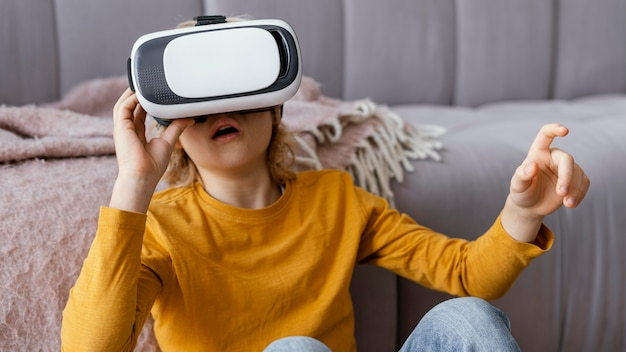 Little boy with virtual reality headset