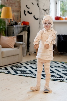 Little boy wrapped in bandage as mummy
