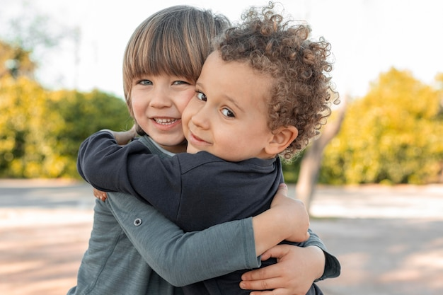 Little boys outdoors hugging