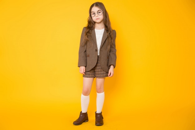 Little brunette girl in costume