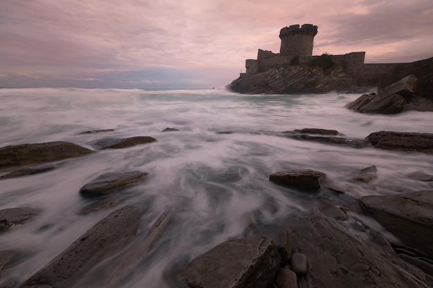 Little castle surronded by the brave atlantic ocean at sokoa (socoa) in the donibane lohitzune bay (saint jean de luz) at the basque country.