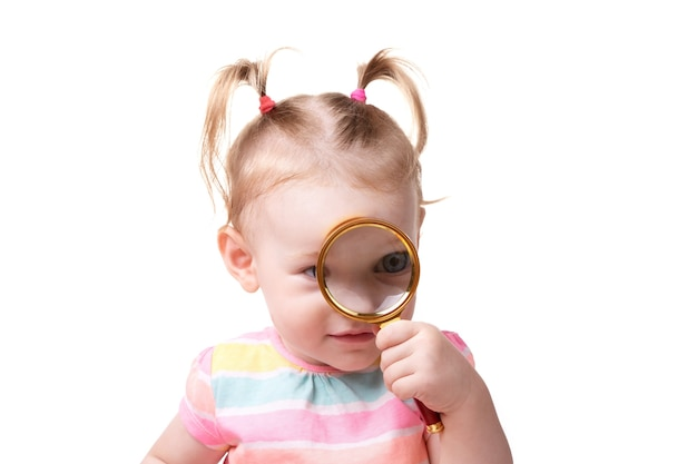 Little caucasian baby girl with magnifier isolated on a white background, search concept