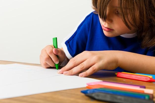 Little caucasian boy drawing
