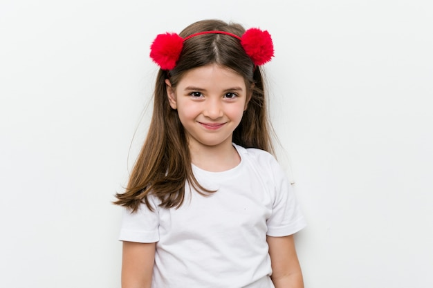 Little caucasian girl with costume and accessories having fun