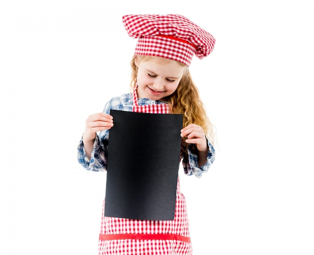 Little chef girl holding piece of paper with free space, isolated