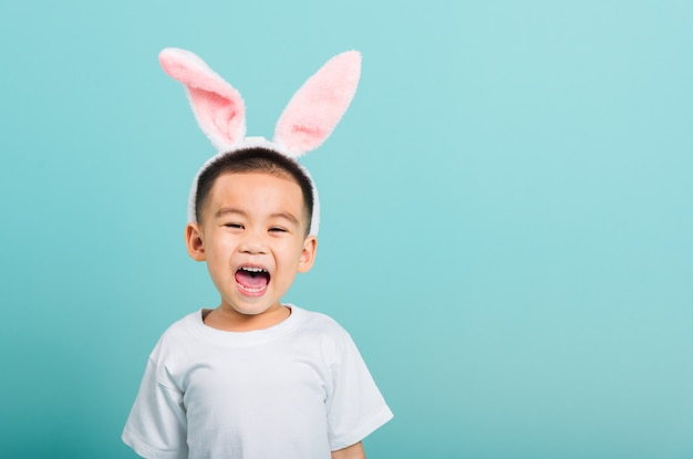 Little child boy beaming wearing bunny ears