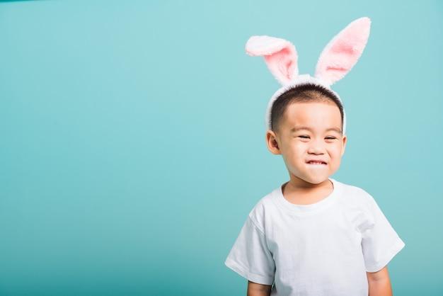 Little child boy smile beaming wearing bunny ears