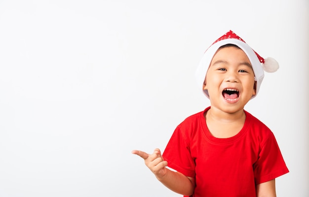 Little child boy smile and excited in red santa claus hat