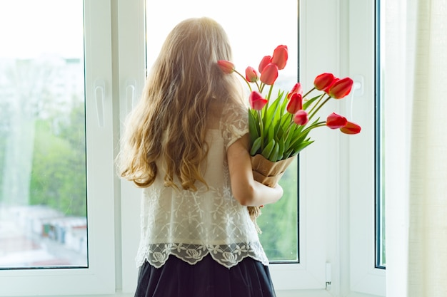 Little child girl holding bouquet
