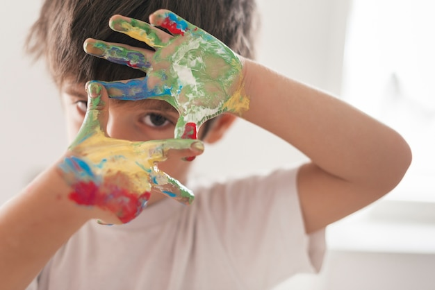 Little child painting like an artist