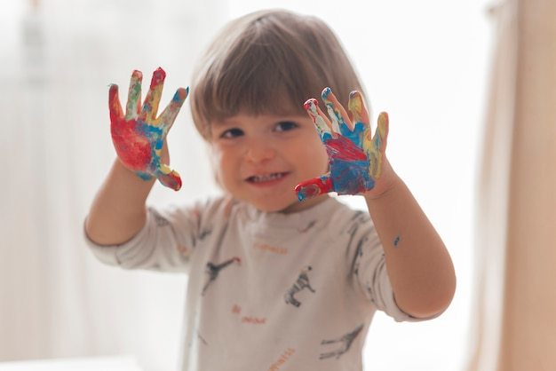 Little child painting like an artist