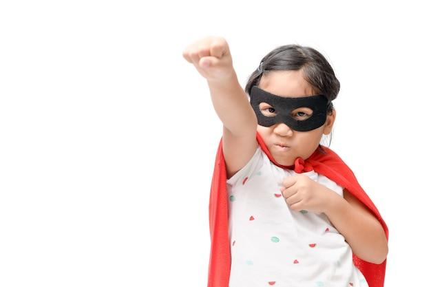 Little child plays superhero isolated on white background