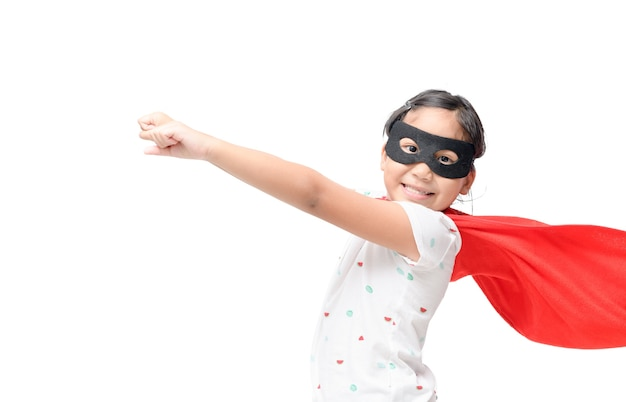 Little child plays superhero isolated on white