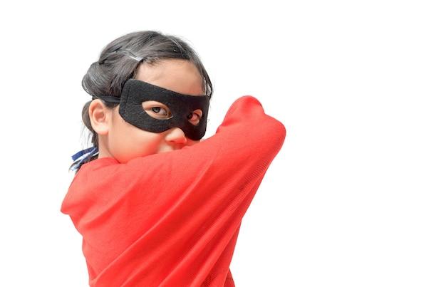 Little child plays superhero isolated