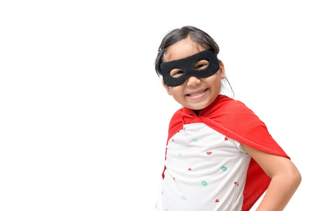 Little child plays superhero and smile isolated on white background