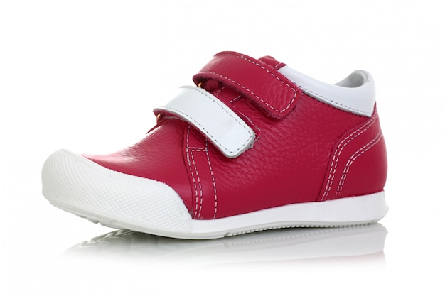 Little child red shoes isolated
